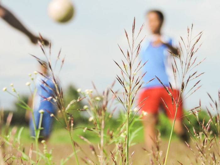 Defocused shot of boys playing soccer