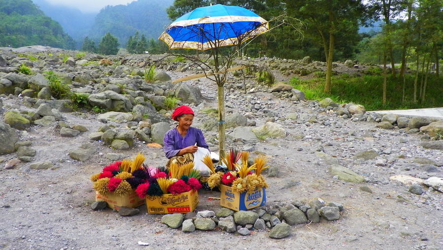 Life under mount Merapi, Java, Indonesia Adult Beauty In Nature Day EyeEmNewHere Flower Happiness Happy People Merapi Volcano Mountain Nature Outdoors People Poor People  Real People Rural Scene Selling Stall Travel Destinations