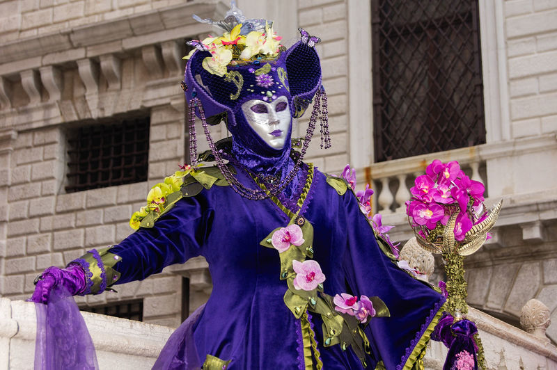 Carnival in Venice Carnival In Venice Adult Architecture Building Exterior Built Structure Carnival - Celebration Event Costume Day Flowers Headdress Headwear Lifestyles Mask - Disguise One Person Outdoors People Performance Period Costume Purple Real People Stage Costume Standing Venetian Mask The Street Photographer - 2018 EyeEm Awards The Portraitist - 2018 EyeEm Awards