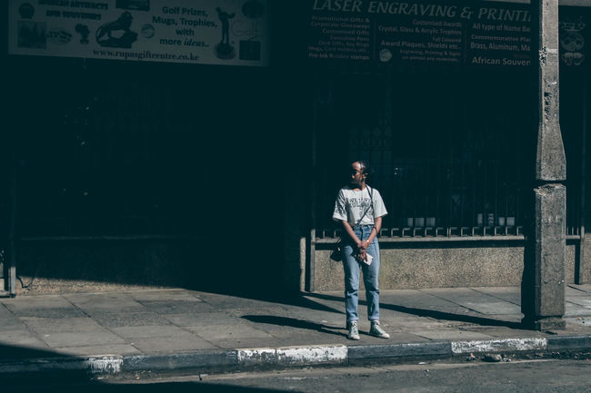 Long shot. Street photography EyeEm Africa EyeEm Best Shots Fresh On Market 2018 Streetphotography Fashion Woman Teenager Street Standing Adult Full Length Front View One Person Young Adult Portrait Outdoors