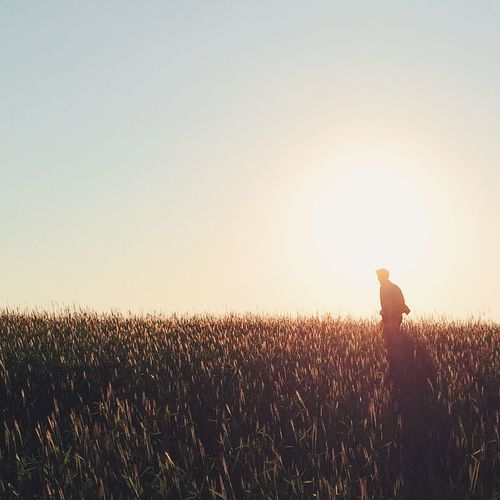 Man Standing On Agricultural Field Against Clear Sky