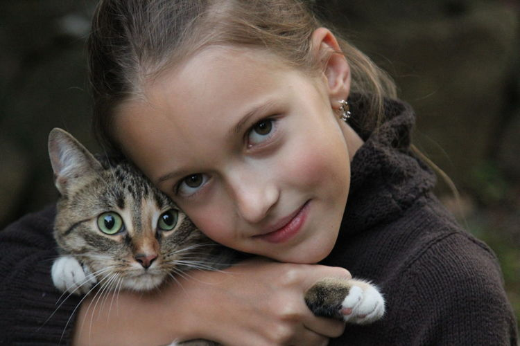 Portrait of cute girl with cat