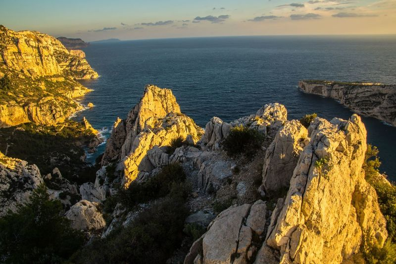 marseille,calanque,bouche du rhone, france Sea Rock Beauty In Nature Rock - Object Water Scenics - Nature Rock Formation Solid Sky Tranquil Scene Tranquility Nature Cliff Idyllic Land Non-urban Scene No People Mountain Horizon Over Water Outdoors Formation Rocky Coastline Eroded