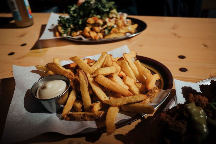 High angle view of french fries served on table