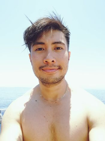 sun kissed EyeEm Selects Water Portrait Sea Headshot Shirtless Summer Human Face Front View Looking At Camera Clear Sky Human Skin Wet Hair Natural Beauty Bare Attractive Human Body Shore Surfer