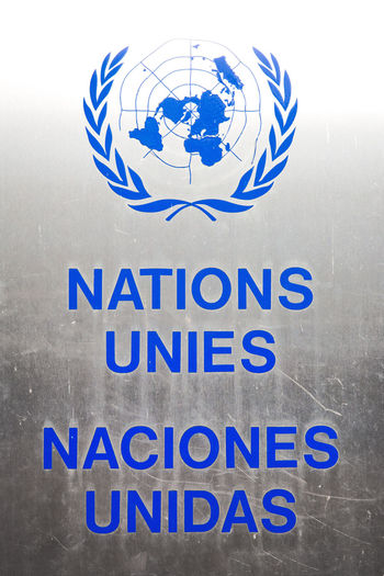 Human Rights International International Law Logo Spanish UN UN - Symbol UNO United Nations Blue Capital Letter Close-up Communication Day French Information Sign International Organisation Metal - Material No People Responsibility Sign Silver Colored Symbol Text Western Script