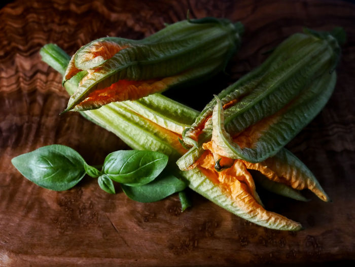Basil Courgette Flower Close-up Focus On Foreground Food Food And Drink Freshness Fruit Green Color Healthy Eating High Angle View Indoors  Leaf Nature No People Plant Part Raw Food Still Life Table Vegetable Wellbeing Wood - Material