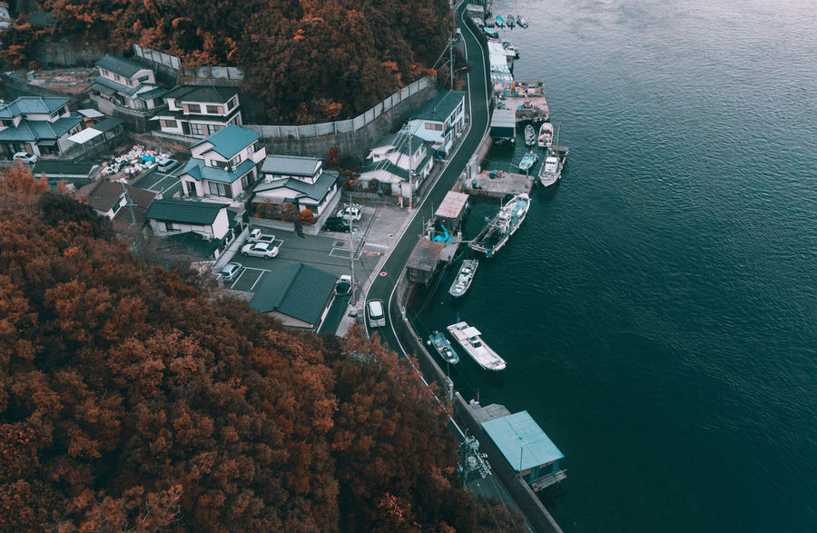 // prime time on the naruto skyline // Amazing AMPt_community Drone  Dronephotography Aerial View Japan Shootermag Landscape View From Above High Angle View Architecture Building Exterior Transportation Built Structure Outdoors Mode Of Transportation No People Water Residential  River Seaside Road Autumn Autumn colors Sony Alpha
