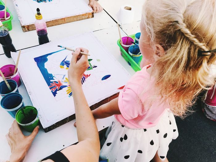 Art And Craft Blond Hair Brush Child Childhood Creativity Drawing - Activity Females Girls Hair Hairstyle High Angle View Holding Indoors  Innocence Leisure Activity Lifestyles Paintbrush Real People Two People Women