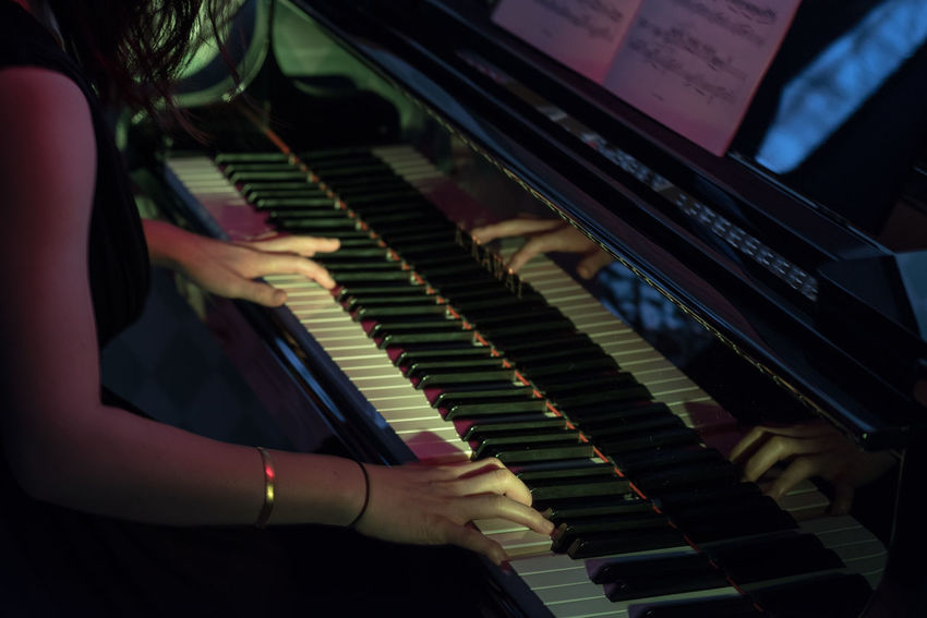 Playing Piano Hands Hands At Work Music Piano Skill  Woman High Angle View Human Body Part Illuminated Indoors  Musical Instrument Notes Piano Playing Real People