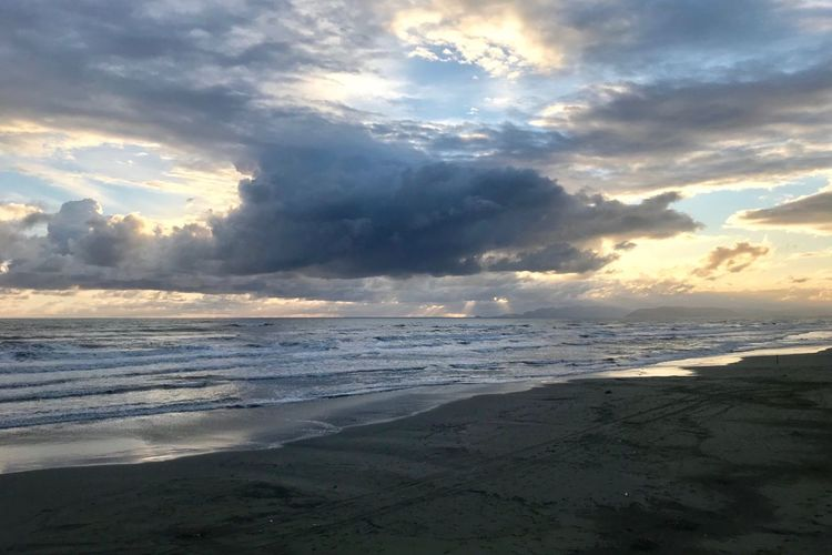 Sea Beach Water Cloud - Sky Sky Land Beauty In Nature Scenics - Nature Horizon Over Water Horizon Wave Sunset Motion Nature Tranquility Tranquil Scene Sand No People Outdoors