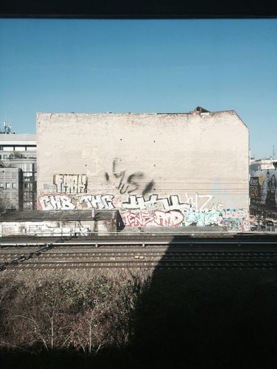 Wall Urban Train Graffiti Rail Berlin Text Architecture Transportation Day No People Outdoors Built Structure