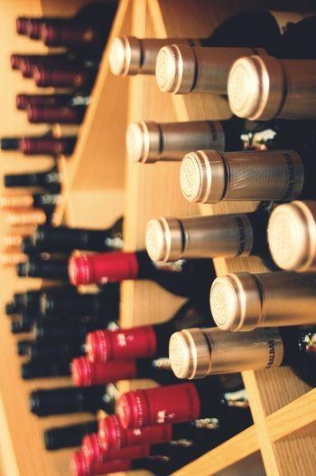 Close-up of wine bottles in rack