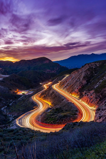 Always turn a negative situation into a positive situation Sonyalpha Photography Sunet Illuminated Winding Road Mountain Sunset Road Curve Light Trail High Angle View Sky Light Painting Long Exposure Mountain Road