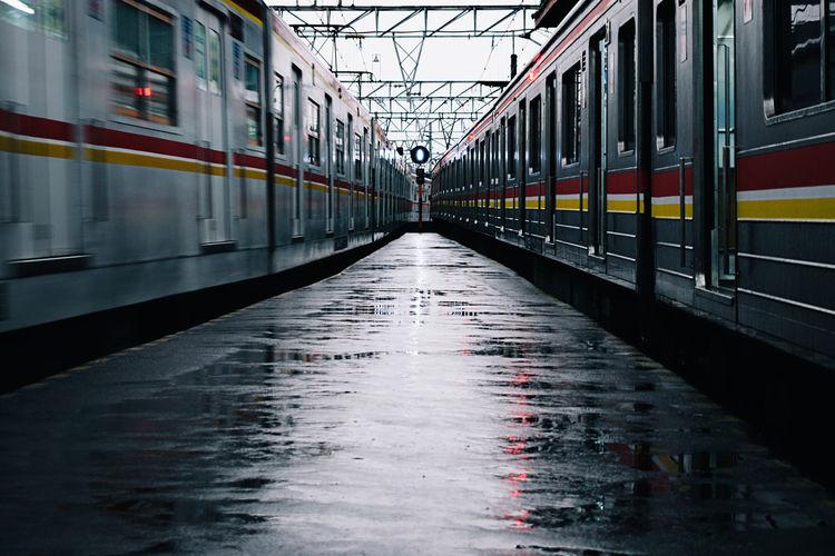 Trains at railroad station during rainy season