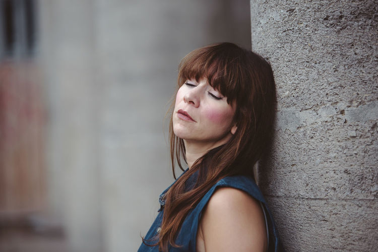 Thinking Adult Bangs Brown Hair Close-up Closed Eyes Column Exhausted Focus On Foreground Headshot Lean Lifestyles Long Hair One Person Outdoors People Portrait Real People Serious Sleeping Thoughtful Tired Young Adult Young Women