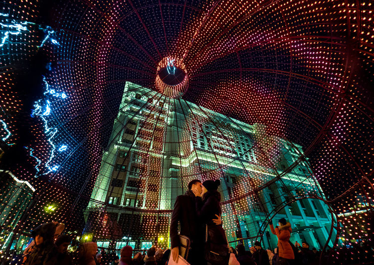 Low Angle View Of People In Illuminate Bauble At Manezhnaya Square