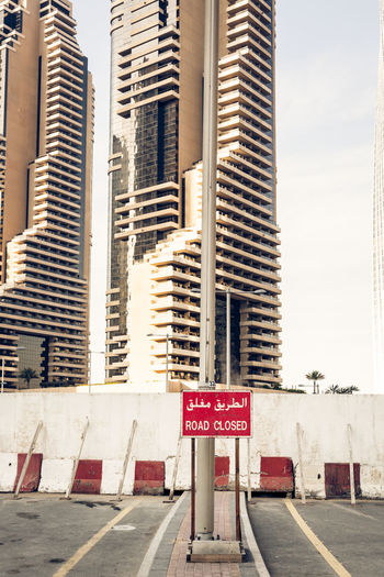 Arabic Script Construction Dubai Road Sign Text UAE Word Arabic Architecture Closed No People Outdoors Road Sign Text