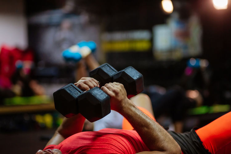 Midsection of man exercising at gym