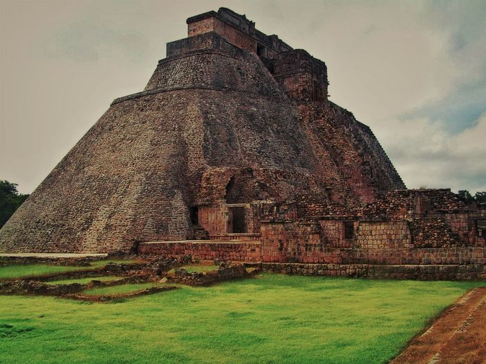 Chitza Nitza, Mexico Mayan Ruins Mexico Ancient Civilization Architecture Building Exterior Built Structure Day Grass History Low Angle View Mayanculture Nature No People Old Ruin Outdoors Pyramid Sky Temple The Past Travel Destinations