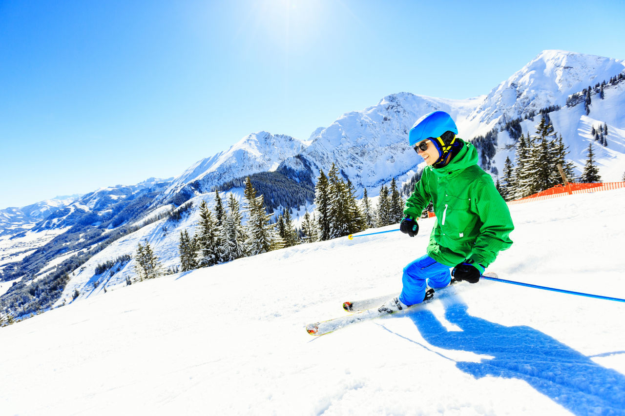 Young Man Skiing On Snow Against Clear Sky