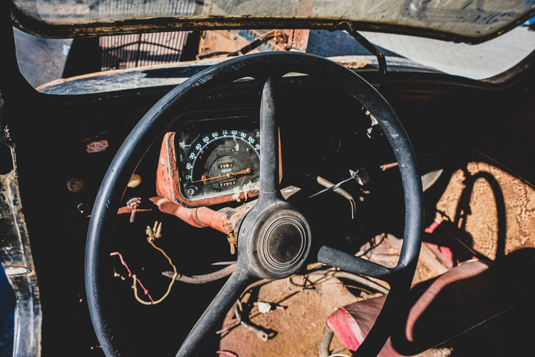 Close-up of steering wheel in abandoned car