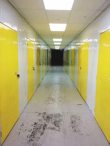 Storage Yellow The Way Forward Empty No People Indoors  Illuminated Storage Units Storage Unit Yellow Doors Closed Corridor