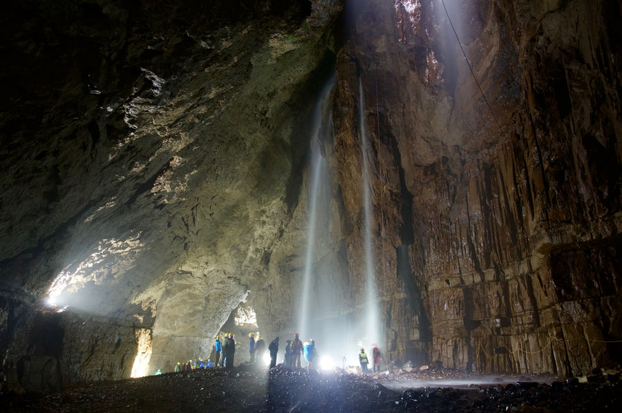 Gaping Gill Light Pothole Yorkshire Adventure Beauty In Nature Cave Cliff Exploration Illuminated Illumination Indoors  Ingleborough Large Group Of People Low Angle View Nature People Rock - Object Rock Formation Water Waterfall