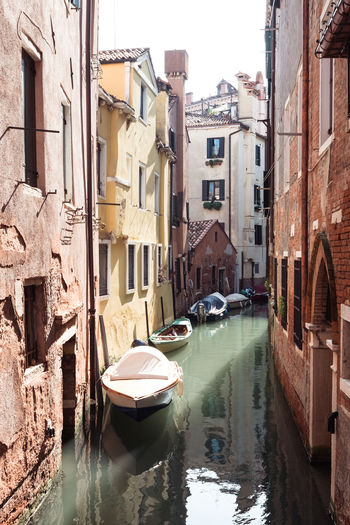 Architecture Building Building Exterior Built Structure Canal City Connection Day Mode Of Transportation Moored Nature Nautical Vessel No People Outdoors Reflection Residential District Rowboat Transportation Venice Water Waterfront