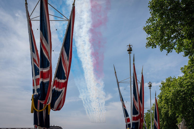 London - Trooping The Colour 2018 Cloud - Sky Day Environment Flag Low Angle View Mode Of Transportation Motion Multi Colored Nature No People Outdoors Patriotism Plant Pole Pollution Red Sky Smoke - Physical Structure Transportation Tree