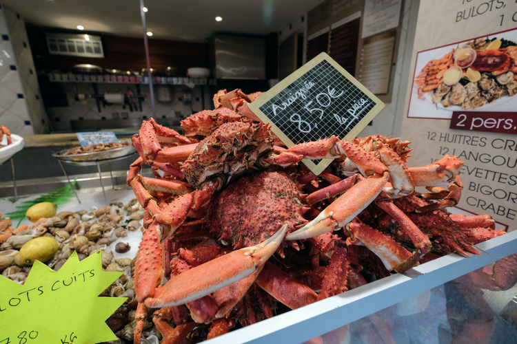 Fresh cooked crab for sale. Creativity Europe Trip France Fresh Crab Ready To Eat Red Saint-Malo Seafood Close-up Day Fish Monger Food Food And Drink For Sale Freshness Healthy Eating Market Meat No People Price Tag Retail  Seafood Small Business Travel Destinations Food Stories