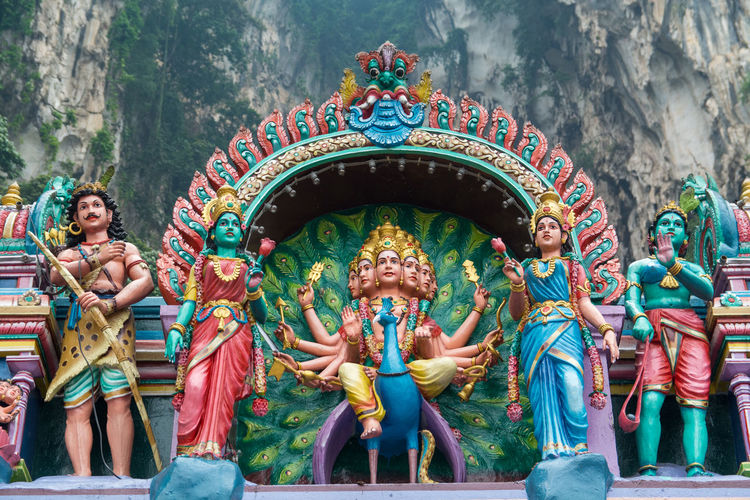 Low angle view of statues at batu caves
