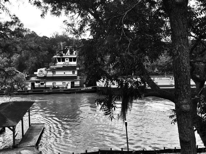 Blackandwhite Light And Shadow Barge Floating Down The San Bernard River Black & White