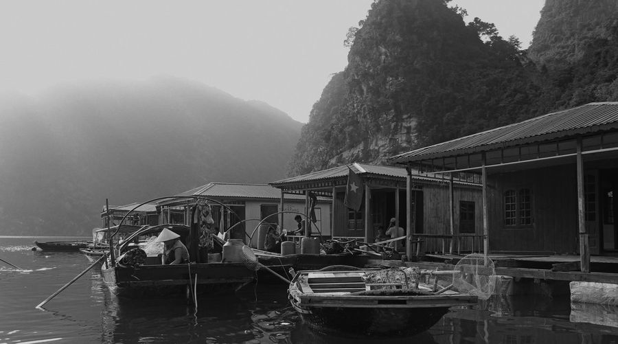 Fishing village in Ha Long Bay. Remnants of it, anyway, as the government has relocated most of it. Black And White Black And White Collection  Black And White Photography Boat EyeEm Best Shots Fishing Fishing Boat Fishing Village Flag Floating Village Halongbay Mountain Mountain Range Nautical Vessel Scenics Sea Seaside This Week On Eyeem Tranquility Travel Destinations Vietnam Vietnamese Water