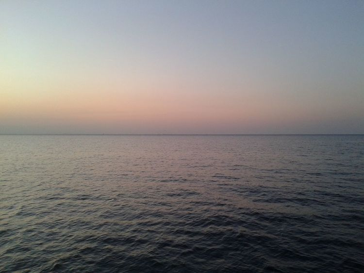 Sky Sea Beauty In Nature Scenics - Nature Water Sunset Horizon Tranquility Horizon Over Water Tranquil Scene Nature Waterfront Romantic Sky Clear Sky Outdoors No People Idyllic