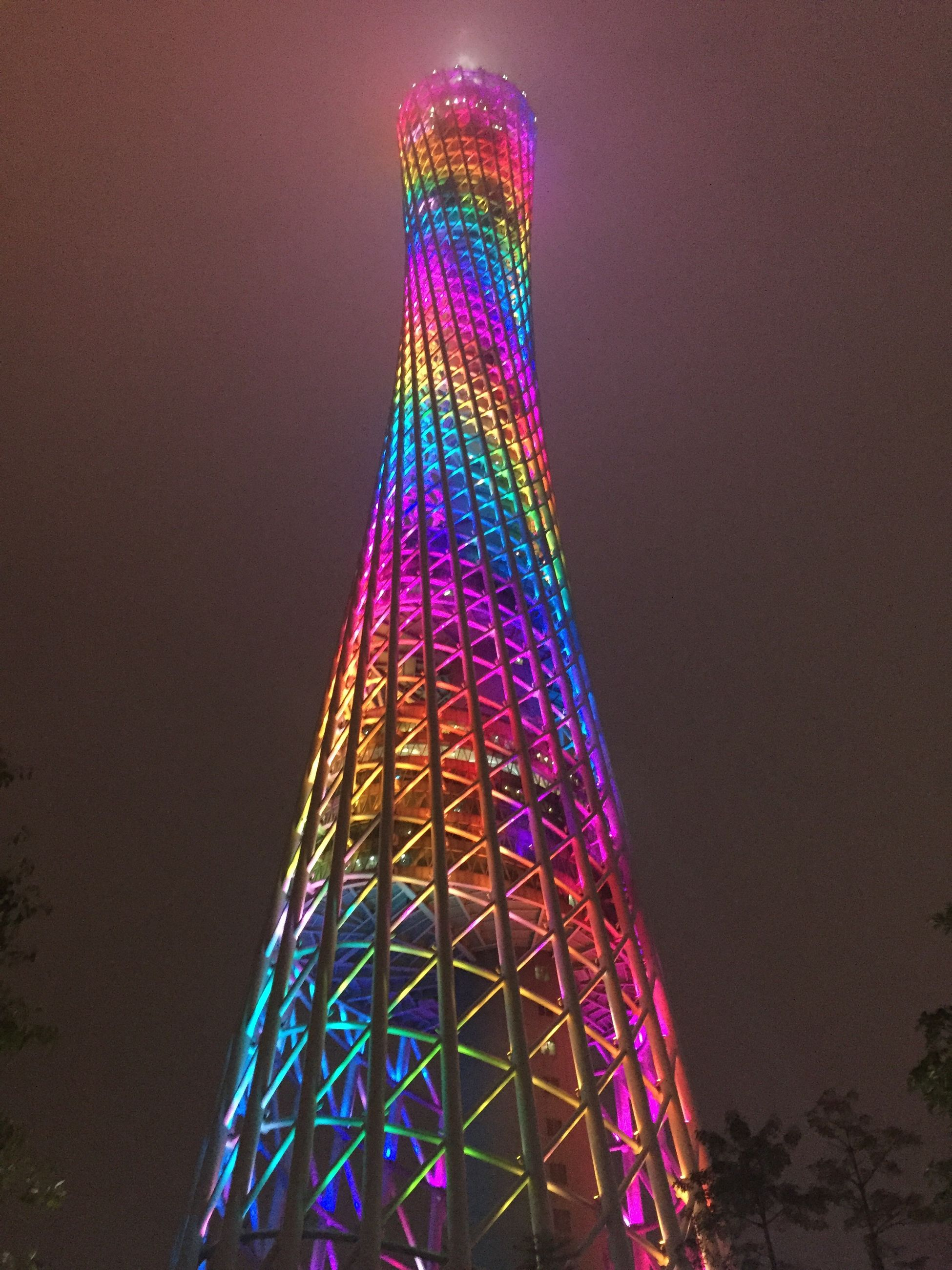 illuminated, tall - high, night, celebration, tower, multi colored, low angle view, no people, architecture, built structure, christmas tree, building exterior, modern, christmas decoration, outdoors, clear sky, sky