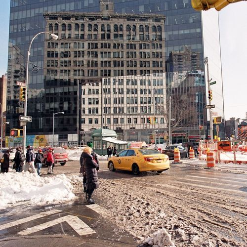 East Village, January 2016 City City Street Yellow Taxi Yellow Cab Nyctaxi Snow Reflection On Building Lomography Color Negative 100 35mm Film Film Photography Ishootfilm Elan7 Street Photography Streetphotography Streetphoto_color Shades Of Winter