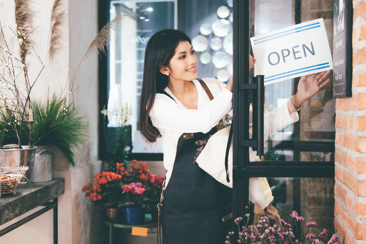 Woman standing by window at store