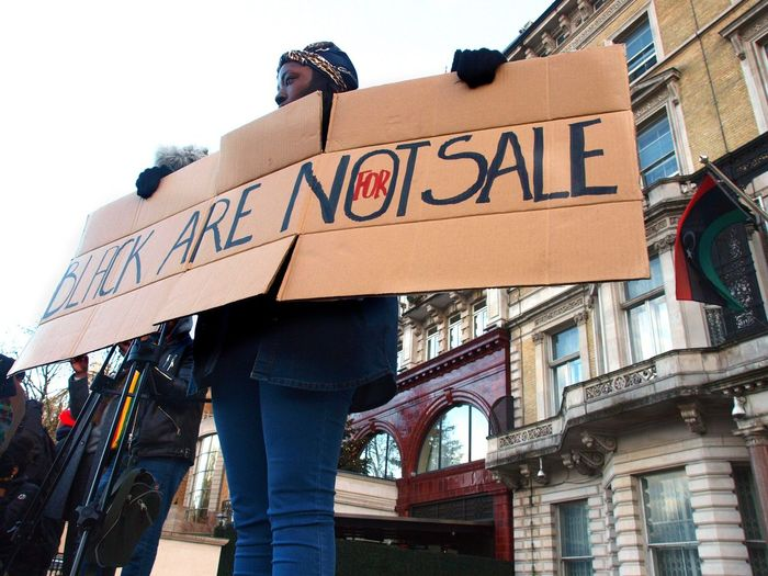 No Borders! No Slavery! Protest demanding an end to auctioning of black Africans in Libya. Following reports of people auctions in Libya. Libyan Embassy. London. UK. 26/11/2017 London News No Borders! No Slavery! Steve Merrick People Auctions Stevesevilempire Olympus Photojournalism Protesters Slavery Still Exists Black Lives Matter Protest London Slavery Libya Protestor Zuiko