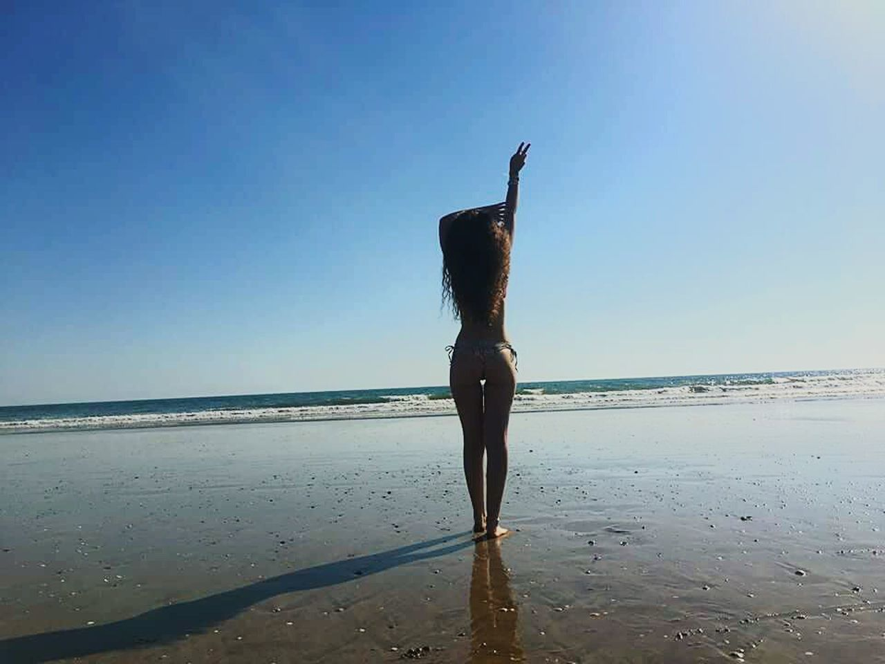 sea, beach, horizon over water, real people, shore, water, clear sky, sky, scenics, beauty in nature, nature, leisure activity, rear view, sand, one person, lifestyles, outdoors, tranquil scene, full length, standing, day, women, people
