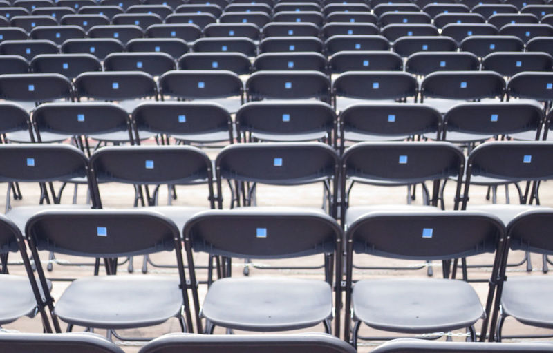 chairs lined up for show Arrangement Auditorium Backgrounds Chair Day Empty Film Industry Folding Chair Full Frame In A Row Indoors  Large Group Of Objects No People Seat Stadium