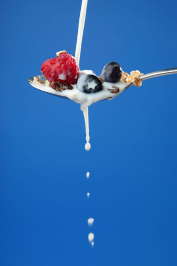 Series of Milk and Healthy Muesli on Blue Background, with fruit and milk splashing Breakfast Drops Spoon Blackberry Blue Blue Background Blueberry Fresh Fruit Healthy Healthy Eating Milk Milk Splash Muesli Raspberry Splash Wholegrain
