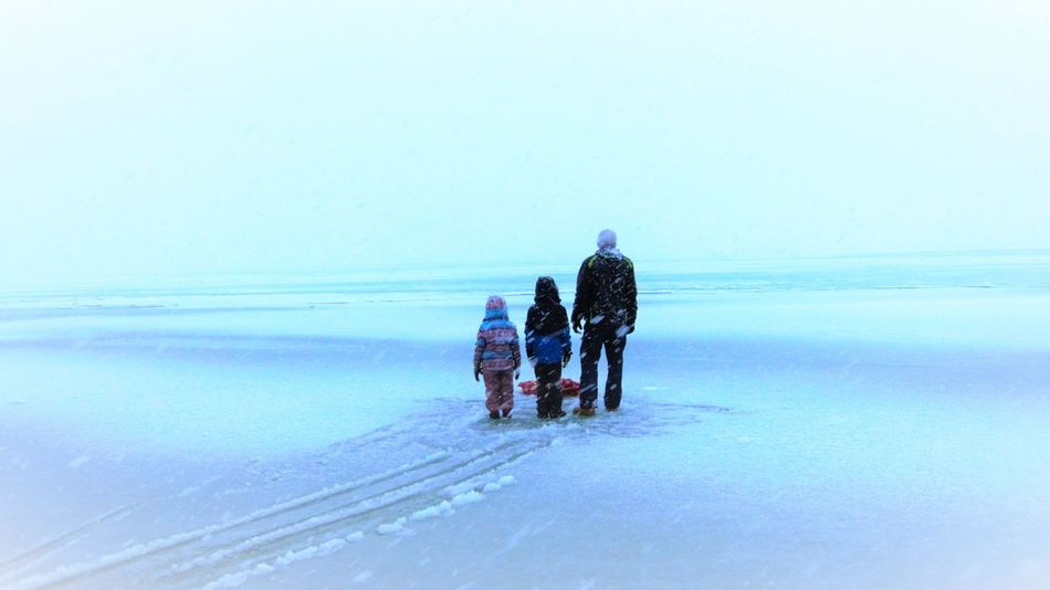 Beauty In Nature Clear Sky Cold Temperature Day Father And Kids Full Length Leisure Activity Men Nature Outdoors Real People Rear View Sky Snow Warm Clothing Weather Winter EyeEmNewHere