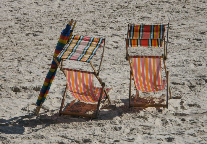 Deck Chair St Brelades Bay Summer Holidays Absence Beach Chair Day Deck Chairs Folding Chair Nature No People On The Beach Outdoor Chair Outdoors Relaxation Sand Summer Sunlight Vacations