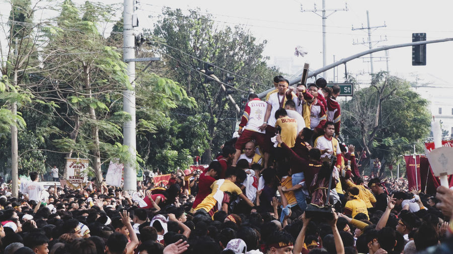 feast of Black Nazarene Feast Catholic Traditional Festival Tradition Tradional Culture Culture And Tradition Culture Of Philippines Nazareth Tree Crowd Popular Music Concert City Togetherness Sky Holi Traditional Festival Festival Protestor Protest Traditional Dancing