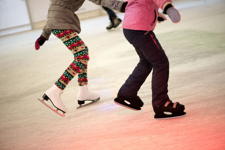 Couple Balance Day Ice Rink Ice Skate Ice Skates Indoors  Leisure Activity Low Section Motion People Performance Playing Real People Skill  Sport Two People