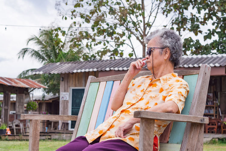 Elderly woman be tired sitting on chair