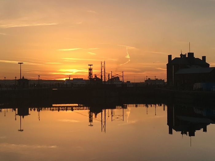 Sun down Water Reflection Sunset Built Structure Sky Waterfront Nature Beauty In Nature Architecture Silhouette Outdoors Factory No People Building Exterior Scenics Welcome To Black