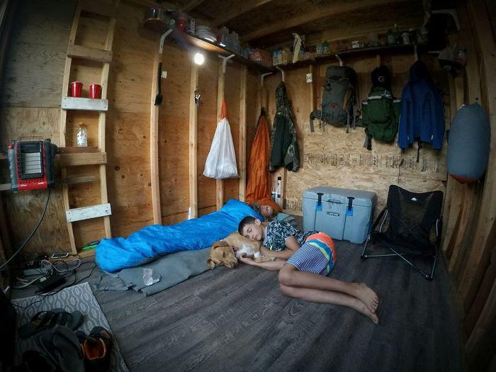 Siblings relaxing in shed