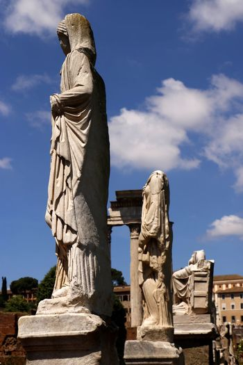 Statues among the ruined remains of the ancient roman forum (foro romano) in the centre of the city of Rome, Italy Travel Photography Ancient Art Ancient Civilization Architecture Art And Craft Cloud - Sky Craft Creativity Day Female Likeness History Human Representation Low Angle View Nature No People Representation Sculpture Sky Solid Statue Stone Material Sunlight The Past Tourist Destination Travel Destination